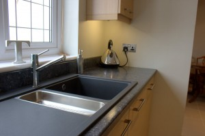 Close up of black Franke sink