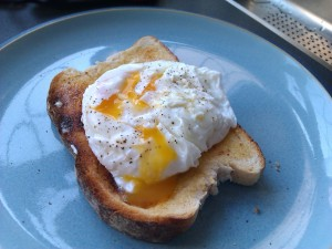 Poached Egg on toast with yolk broken