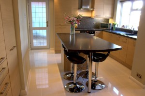 The whole kitchen, with black sink